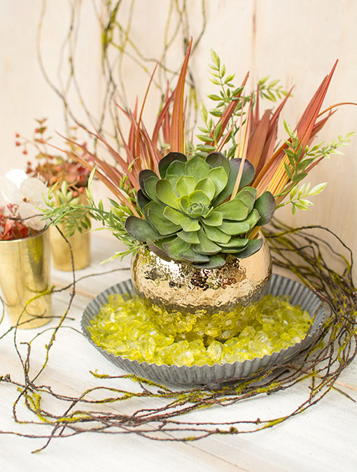 Fill a tin pan with this vase filler and arrange a hammered pot with realistic tall grass, wisteria and a succulent on top. Wrap a moss vine around the set to complete your woodland wedding centerpiece.