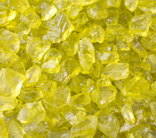 This 4.2 pound container holds an assortment of rock sizes that are a clear green color.