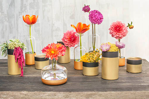 Arrange a table with these bud vases, our gold and black holders and colorful flower arrangements for modern spring wedding decor.