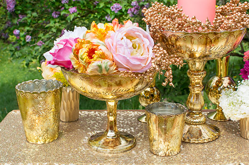 Display this gold toned alongside our antique styled candle holders and bouquets of flowers. Complete the scene with a sequin table runner.