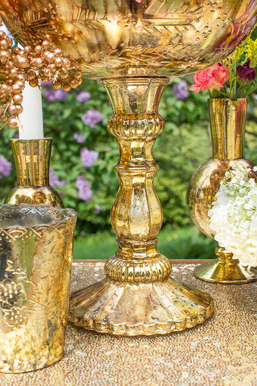 This bowl with pedestal stands 9.5 inches tall with an 8 inch diameter to showcase floating candles, bouquets and wrapped candies.