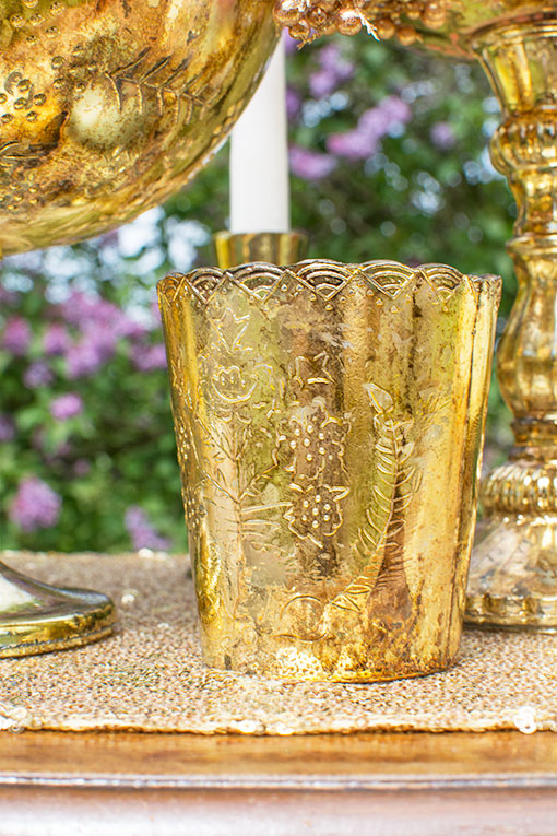 Each scalloped bud vase stands 3.5 inches tall and has a 2.75 inch diameter opening to hold small bouquets and most tea light and votive candles.