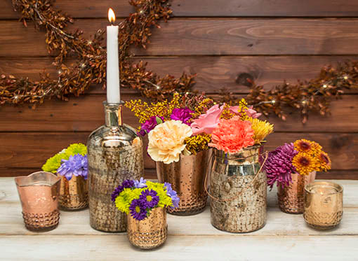 Create a rustic romantic tablescape by combining our vases with our gold mercury glass candle holders and gold and bronze apothecary bottle and lantern.