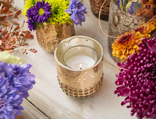 Each vase is capable of holding most votive and tea light candles and has a reflective interior to amplify the candle's glow.