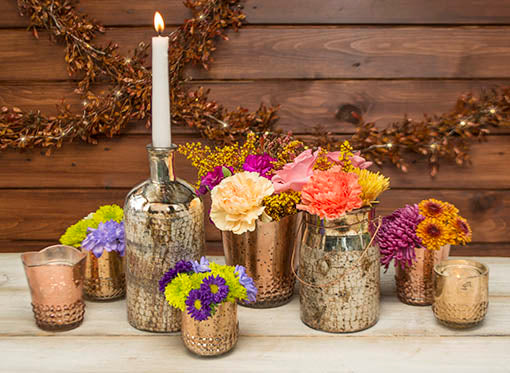Create a rustic romantic tablescape for your event by combining our rose gold vase with our gold mercury glass candle holders, apothecary bottle and lantern.