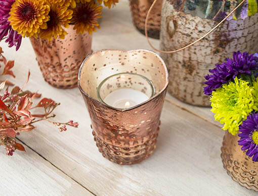 Easily fit most votive and tea light candles in each holder for romantic lighting in your design.
