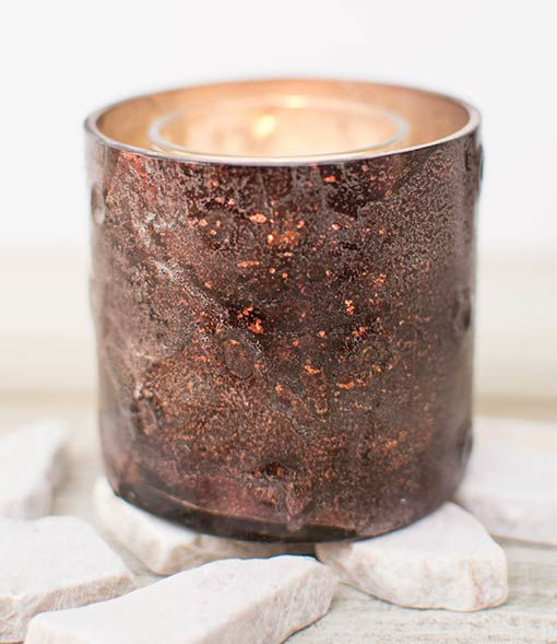 The gold toned interior produces a reflective and warm glow from candle flames or fairy light glow.