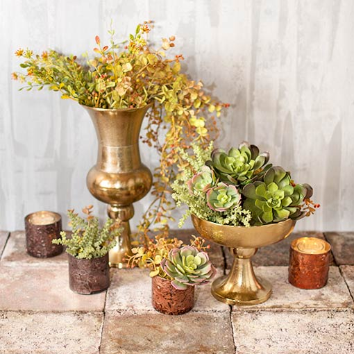 Create a timeless display in your wedding with our rose gold toned compotes, mercury glass candle holders and a plethora of sprigs and sprays.