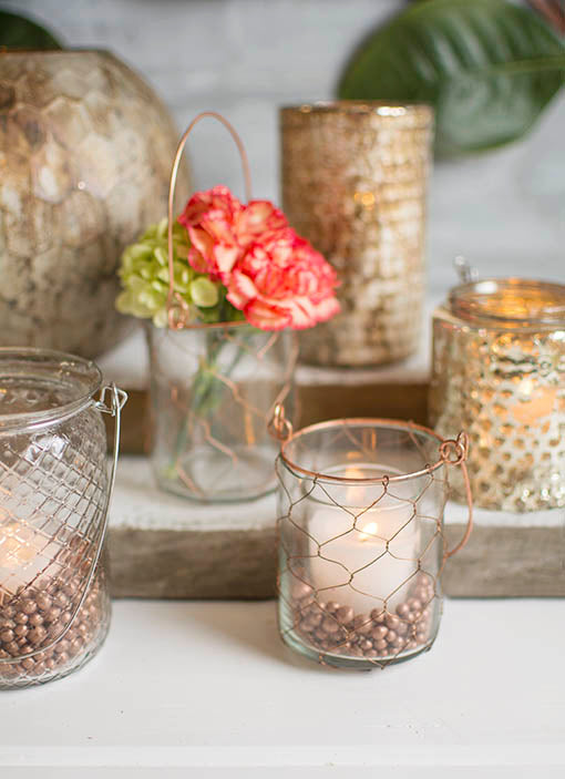 Arrange this vessel with our clear glass hanging jar and mercury glass collection for vintage romantic impressions in your wedding.