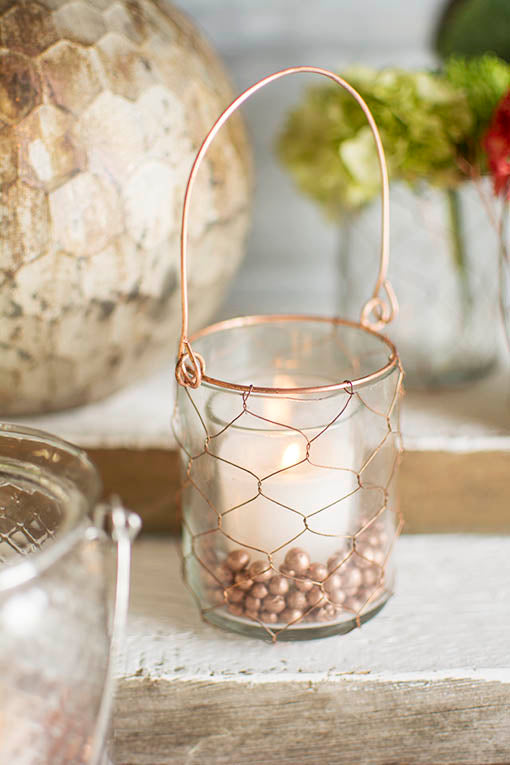 Fill this petite holder with vase filler and a votive candle for romantic elegance in your tablescapes.