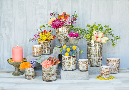 Add the modern style of our marbled glass candle holders, vases and compotes to your wedding or venue design. Fill these vessels with tea light and pillar candles, flowers, buds, sprigs and vase filler.