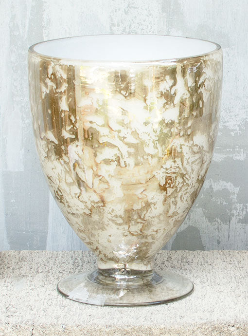 This vase stands 6.5 inches tall with a 4.75 inch opening diameter ideal for large floral bouquets.