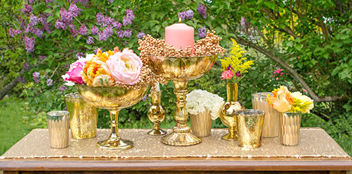 Fill your outdoor wedding in shades of gold! Place our carved candle holder alongside compotes, bouquets and bud vases.