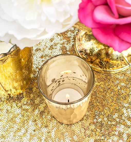 Arrange this candle holder on a gold colored sequin table runner for a modern display in your event or wedding.
