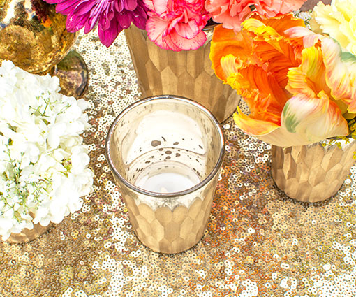 Style a votive candle in this holder and dazzle the centerpiece with a sequin table runner.