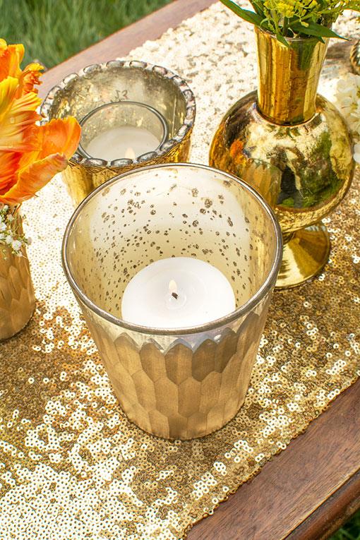 Fill this holder with a votive candle and dazzle the table with a sequin table runner.