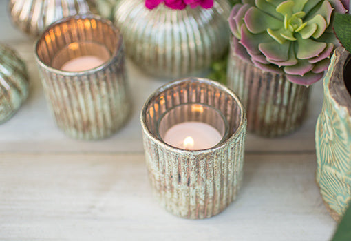 Add a votive candle to this holder for a romantic addition to your wedding tables.