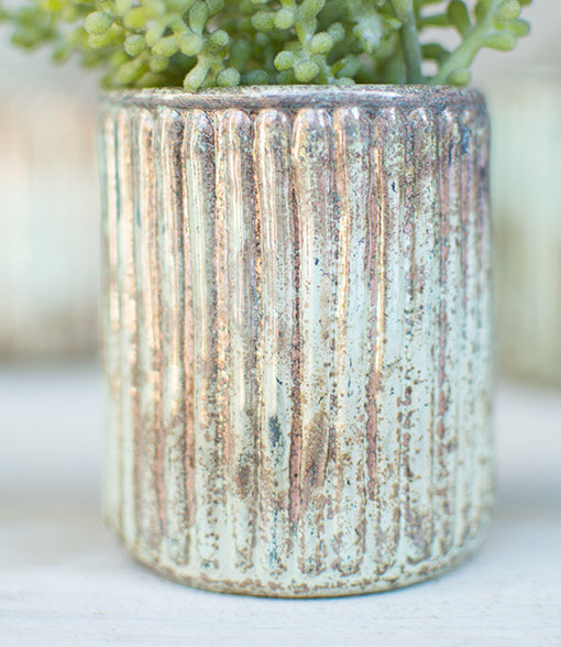 This mint and copper vessel stands 3.25 inches tall with a 2.5 inch opening ideal for most tea light and votive candles.