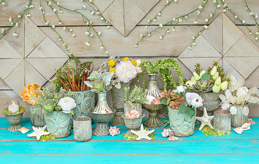 Arrange these candle holders in an enchanted sea wedding setting. Combine the set with seafoam vases, antique grey compotes, sprigs and flowers for lush table setting. Finish the look with green vase filler, seashells, starfish and cherry blossom branches above the display.