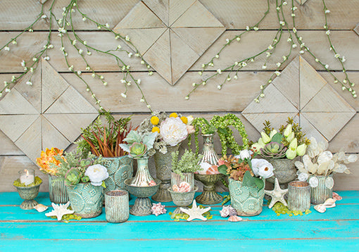 Enchant your wedding or restaurant with a seaside display. Arrange these candle holders with sprigs, flowers, seashells, starfish, seafoam colored planter pots and antique grey compotes for a colorful beach display.