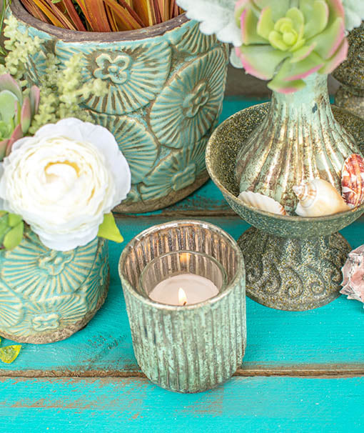 Illuminate your tablescapes by placing a votive candle in each candle holder.