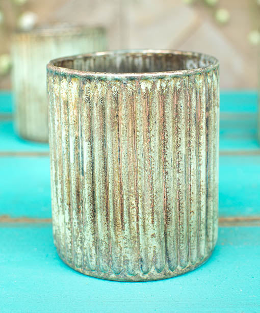 Standing 3.75 inches tall, this mint and copper toned vessel has a 3 inch opening fitting for most tea light and votive candles.