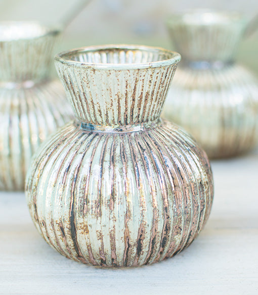 Each 4.5 inch tall verdigris inspired vessel perfectly displays flowers and sprigs with its 2.75 inch top diameter.