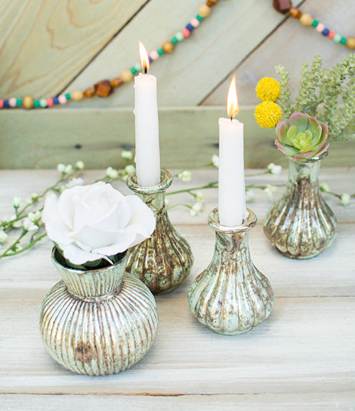 Place taper candles in this bottle and set the table with our other patina inspired vases, a beaded garland, flowers and succulents.
