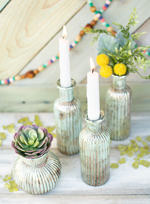 Place a taper candle in this bottle for a romantic decoration in your wedding.