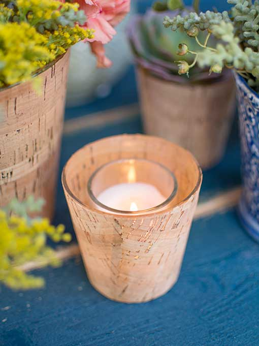 Easily place a votive or tea light candle in this glass holder for modern romantic lighting.
