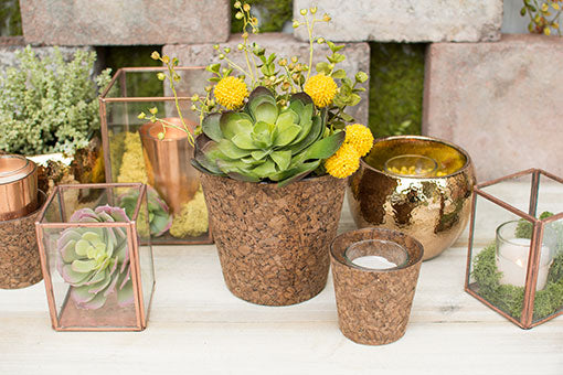 Cork vases and candle holders add a natural element to modern tablescapes. Arrange these with succulents, terrariums and gold toned planter pots for a one-of-a-kind garden design.