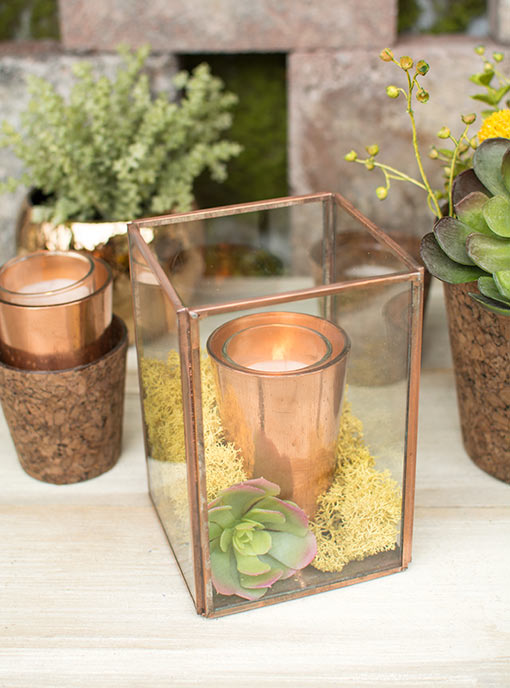 Add a copper candle holder, succulent, moss and votive candle to this box for your industrial garden wedding. Complement the display with cork vases and sprigs.