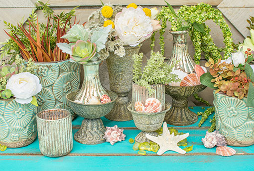 Enchant your beach wedding with the rustic details of our antique grey compotes. Style this vessel alongside seafoam colored vases, patina inspired candle holders, green glass, seashells and starfish.