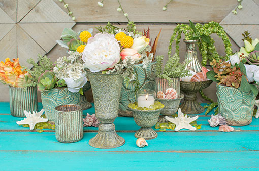 Create an enchanting beach wedding display by pairing our rustic compote with patina inspired candle holders, seafoam colored planter pots, shells, starfish and other antique grey compotes.