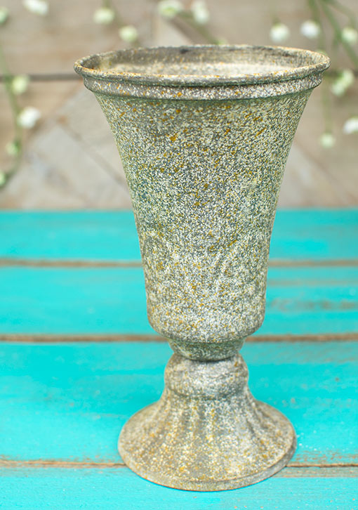 Standing 7.25 inches tall, this decorative urn becomes the perfect vessel for vase filler and a tea light or votive candle.