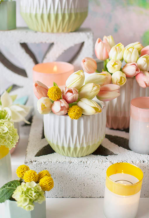The soft details of the decorative tulips and billy buttons complement the geometric design of our ceramic vase. Fill an entire centerpiece with this vessel, our semitranslucent candle holders and hexagonal planter pots for a garden styled wedding.