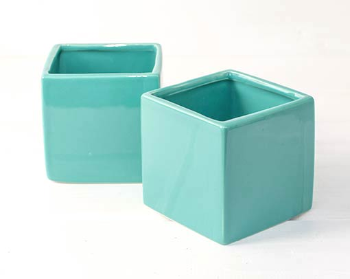 Pair this neon blue planter box with white hobnail vases and red candles and flowers for your summer wedding, or combine this cube flower pot with clear glass decor and realistic sprigs in your home.