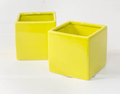 Arrange this chartreuse planter box in your wedding with the teal blue square vase and pink candle holder, or use this lime green holder to display straws at your drink station or utensils at the buffet.