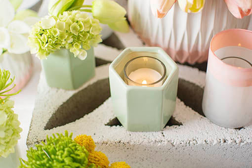 Illuminate romantic wedding moments with a votive candle in each holder.