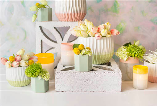 Delight wedding tables with the springtime elegance of our seafoam vase, frosted candle holders and geometric planter pots displaying an abundance of decorative floral bouquets.