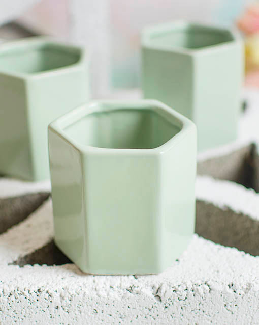 Add filler and a pillar candle to the mint green vessel for a unique candle holder, or display upon a lace runner for a vintage chic wedding.