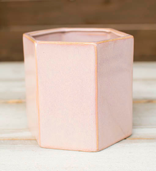 Each ceramic planter pot stands 5 inches tall with a 5.25 inch width that perfectly holds floral bouquets, moss filler and decorative greenery.