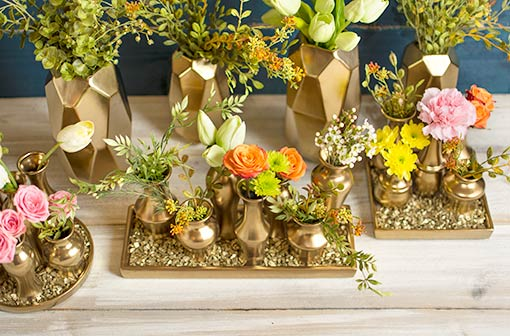 Fill your table with gold! Combine these geometric holders with our larger faceted ceramic vessel and vase cluster. Add plenty of greenery and flowers and gold toned vase filler to complete this rich design.