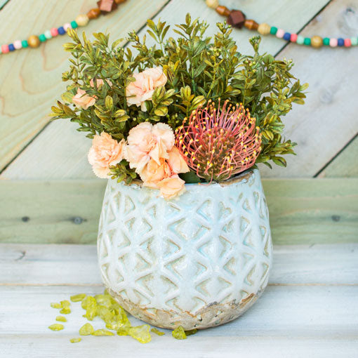 With a 6.5 inch height and 5 inch opening diameter, overflow this vase with cascading sprigs, large flower blooms and captivating succulents.