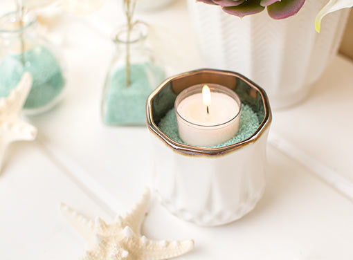 Fill this vessel with seafoam colored vase filler and place a votive candle inside for your beach chic event. Don't forget the starfish for this seaworthy escape.