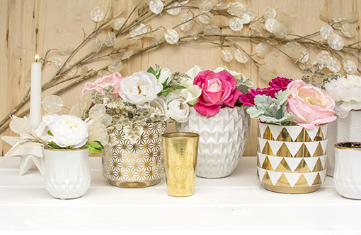 Treat your tablescape our collection of geometric decor! This star patterned vase pairs perfectly with our triangle planter pot, faceted candle holder, gold toned bud vase, origami vase and a silver dollar spray.