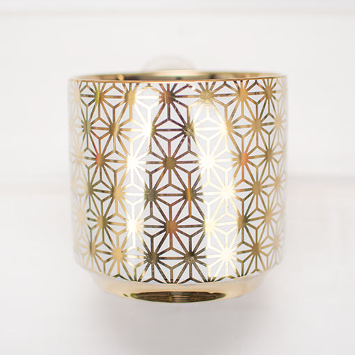 Each vessel stands 4.75 inches tall with a 4.25 inch opening diameter to fit bouquets and short pillar candles.