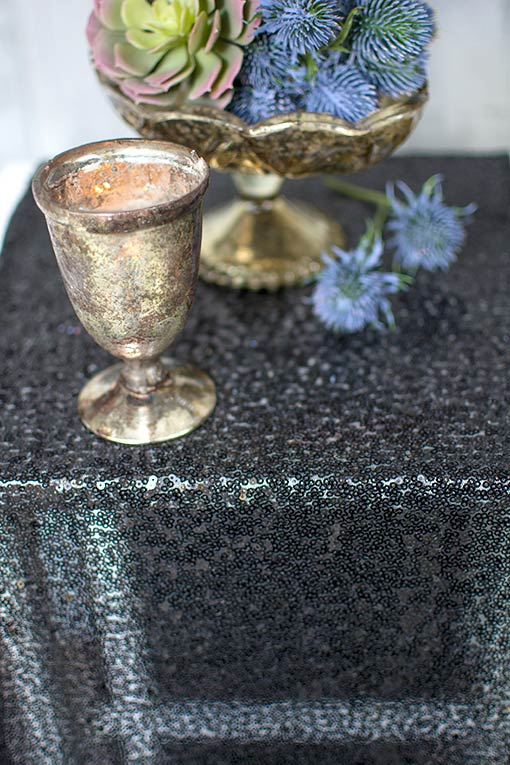 Add succulents and purple thistle to gold mercury glass for a rich table setting.