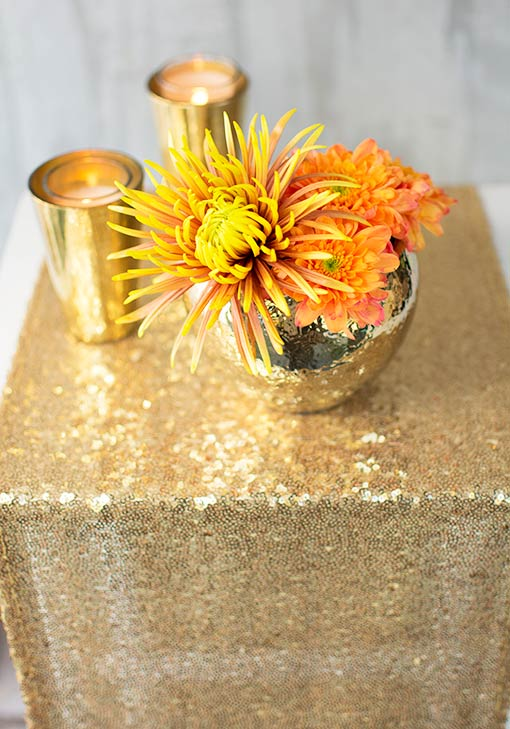 Gold decor ups the elegance ante in any setting! Join our table runners with florals and candlelight for a glowing, magical table.