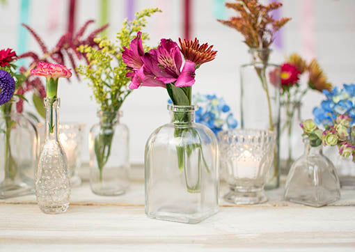 Mix and match these classic clear bottles with textured glass for an elegantly understated look.